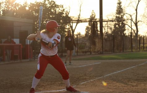 Senior catcher, Kayla Neff, gets ready to hit the ball.