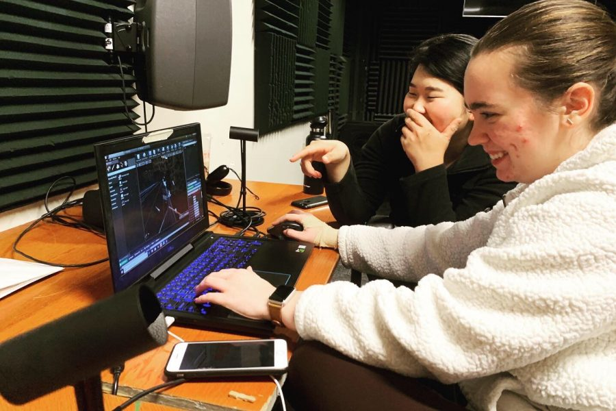 Alumna Emily Inaba and senior cinema and media arts major Megan Scott work on the senior thesis project.