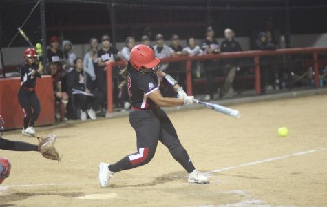 Softball squeezes by in back-to-back victories