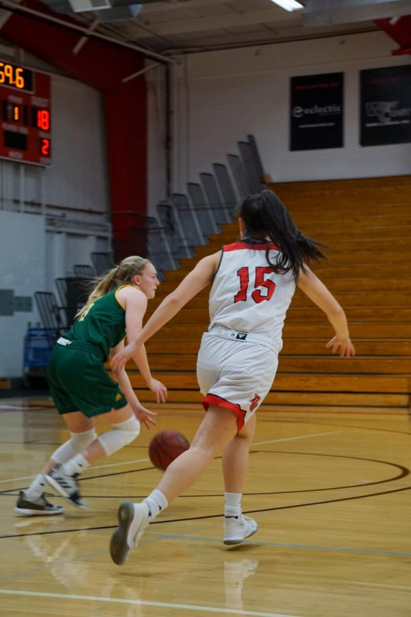 Sophomore #15 Stephanie Lee going head-to-head against Concordia player.