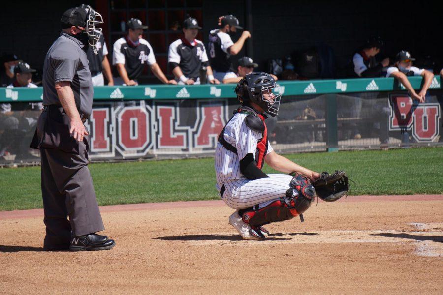 Junior catcher #9 Ben Smith in position.