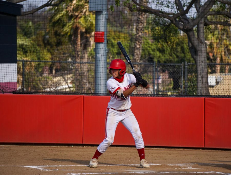 Junior #7 Ruth Munoz up to bat.