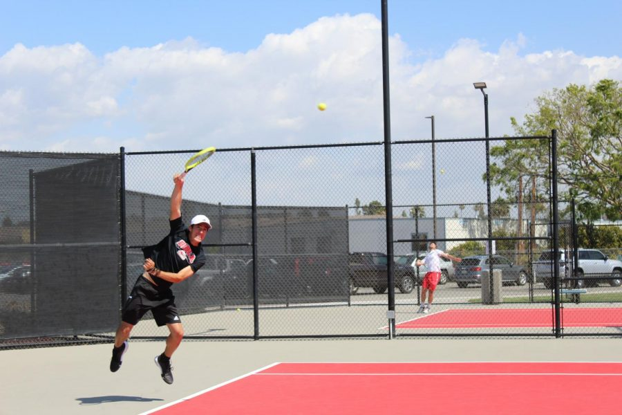 Sophomore+Alex+Sedeno+jumps+to+hit+the+ball+during+Biola%27s+match+against+Metro+State.+