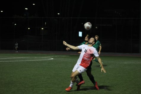 Midfielder Daniel Simonis fights for the ball during Biolas game against CUI.