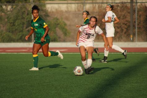 Midfielder Katelyn Penner gets ready to pass the ball to a team member
