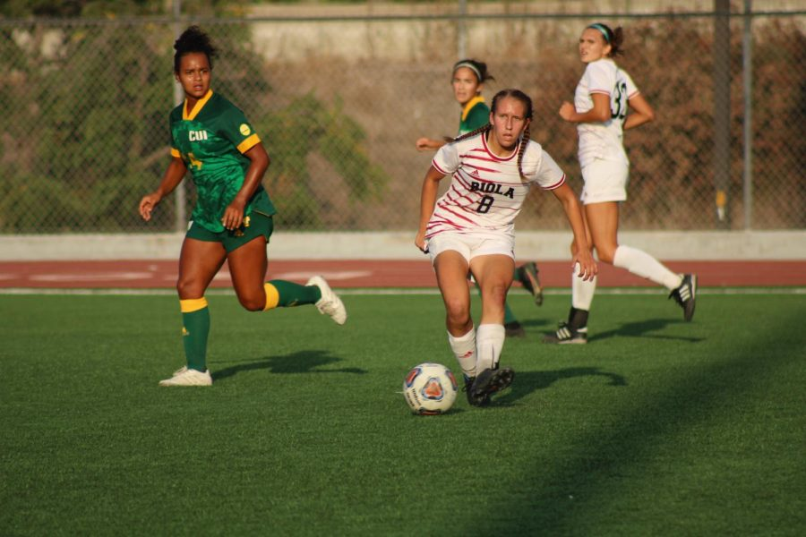 Midfielder+Katelyn+Penner+gets+ready+to+pass+the+ball+to+a+team+member